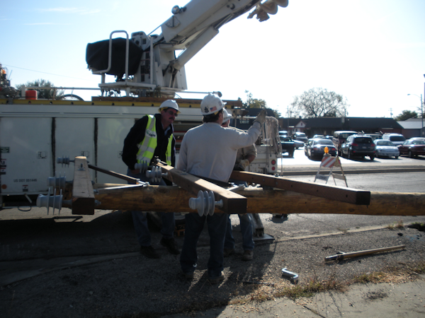 Public Utility Crew Setting a Pole