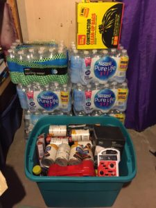 Preparedness Kit with cases of water and garbage bags